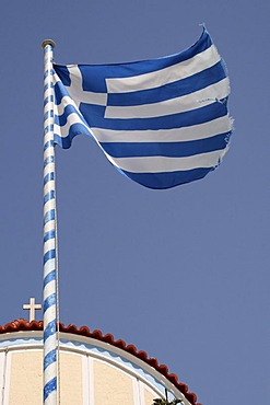 Fluttering Greek flag, Olympos, Karpathos island, Aegean Islands, Aegean Sea, Dodecanese, Greece, Europe