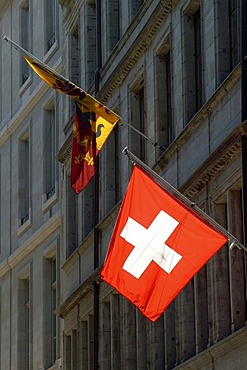 Genevan and Swiss flag in the Rue de l'Hotel de Ville in the historic centre of Geneva, Switzerland, Europe