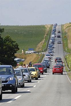 Queue of cars on a straight road, Kivik, Schonen, Schweden, Scandinavia, Europe