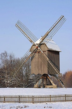 Historic post mill in snow, winter in Hessenpark, Neu-Anspach, Taunus, Hesse, Germany, Europe