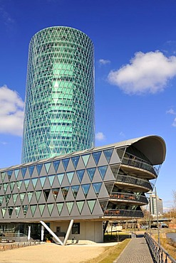 The Westhafen Tower, Western Harbour Tower, with a modern apartment building on Westhafenplatz, Frankfurt am Main, Hesse, Germany, Europe