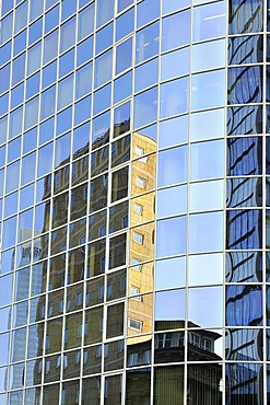Office buildings are reflected in a glass facade, downtown, Frankfurt am Main, Hesse, Germany, Europe