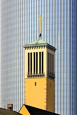 The bell tower of the Matthaeuskirche church, in the back the aluminium facade of the Pollux high rise office building in the financial district, Frankfurt am Main, Hesse, Germany, Europe