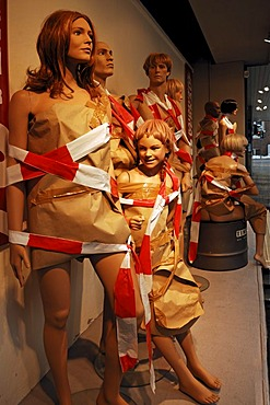 Window dummies decorated with wrapping paper and barrier tape, during a clearance sale in a sports store, Erlangen, Middle Franconia, Bavaria, Germany, Europe