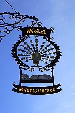 "Elaborate advertising sign ""Hotel Pfauen"" hotel peacock, Hauptstr. 78, Endingen am Kaiserstuhl, Baden-Wuerttemberg, Germany, Europe"