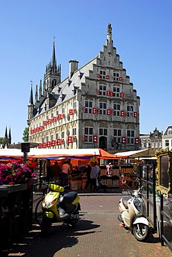 Two scooters, in the back the Stadhuis Gothic city hall on the market square of Gouda, Zuid-Holland, South Holland, the Netherlands, Europe