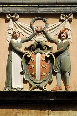 Relief of two orphans at the entrance of the library, a former orphanage, Gouda, Zuid-Holland, South Holland, The Netherlands, Europe