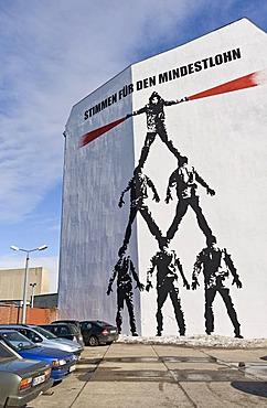 """""""Stimmen fuer den Mindestlohn"""", voices for the minimum wage, """"Die Menschenpyramide"""", man pyramid, mural by Victor Ash on Schiffbauerdamm, Berlin, Germany, Europe"""