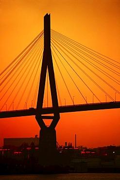 Koehlbrandbruecke Bridge, bridge piers, backlit, sunset, Hamburg, Germany, Europe