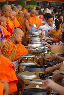 Theravada Buddhism, That Luang Festival, Tak Bat, monks standing behind alms bowls, hands, believers, pilgrims giving alms, orange robes, Vientiane, Laos, Southeast Asia, Asia