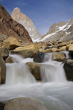 Small waterfall in front of the summit of Mt. Fitz Roy, El Chalten, Andes, Patagonia, Argentina, South America