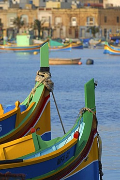 Details of luzzus, the typical colorful fishing boats of Malta, in Marsaxlokk Harbour, Malta, Europe