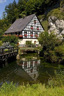 Idyllic water mill at Pottenstein, Naturpark Fraenkische Schweiz nature preserve, Franconia, Bavaria, Germany, Europe