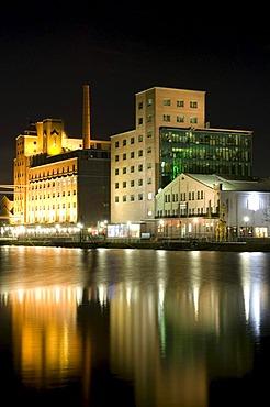 Hafenforum office building in the Innenhafen Duisburg inner harbor at night, Ruhrgebiet area, North Rhine-Westphalia, Germany, Europe