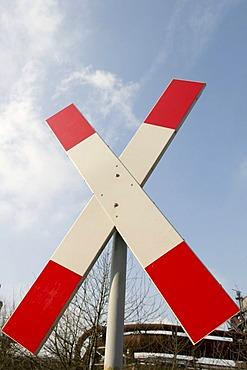 Crossing sign, saltire, at a level crossing, Landschaftspark Duisburg Nord landscape park, Ruhrgebiet area, North Rhine-Westphalia, Germany, Europe