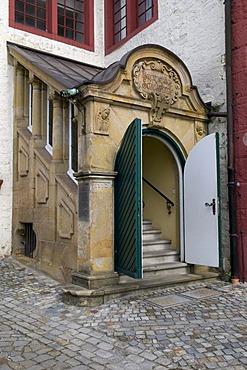 Entrance to the Evangelische Schlosskirche Protestant castle church in the castle courtyard, Schloss Iburg castle, Bad Iburg, Osnabruecker Land region, Lower Saxony, Germany, Europe