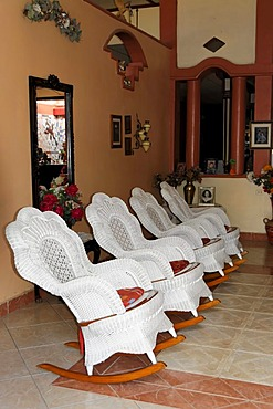 Rocking chairs in the entrance hall of a hotel, Granada, Nicaragua, Central America