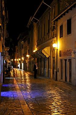 Decumanus at night in Porec, Croatia, Europe
