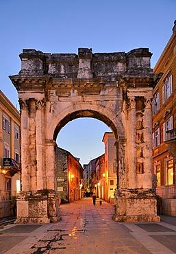 Triumphal Arch of the Sergii at night in Pula, Croatia, Europe