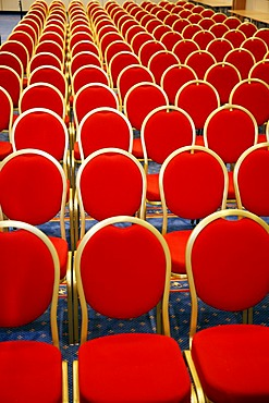 Conference room with red chairs in a row