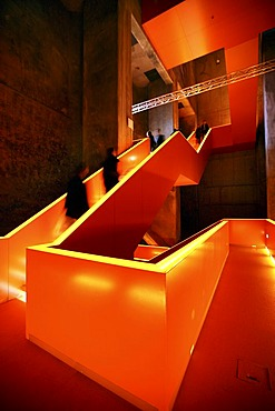 Red illuminated main staircase in the new Ruhrmuseum museum, opened in January 2010, Capital of Culture year, in the former coal washing plant of the Zeche Zollverein mine, World Heritage Site, Essen, North Rhine-Westphalia, Germany, Europe