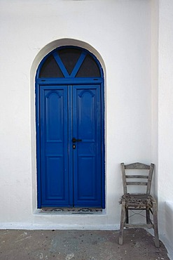 Chair in front of the Agii Apostoli church, Amopi, Karpathos island, Aegean Islands, Aegean Sea, Greece, Europe