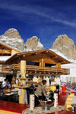 Skiers in front of the Rifugio Salei bar and restaurant, Sella Pass, Sassolungo Mountain, Sella Ronda ski trail, Val Gardena, Alto Adige, Italy, Europe