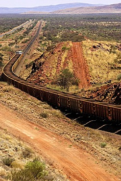Fully loaded iron ore train travelling from Mount Tom Price to Karratha, Western Australia, Australia