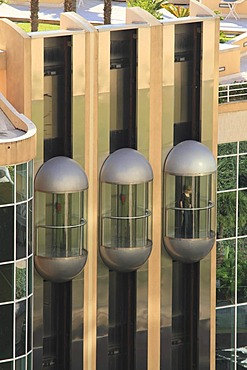 Three glass elevators on the facade of the Hotel Le Meridien Beach Plaza, Le Larvotto, Monaco, Cote d'Azur, Europe