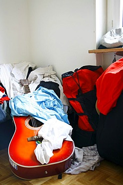 Messy room, student room with a guitar