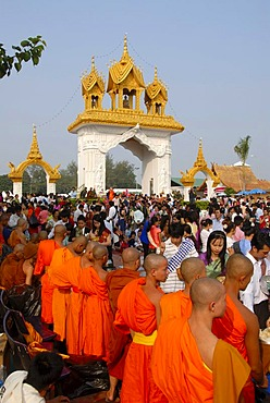 Theravada Buddhism, That Luang Festival, Tak Bat, believers, pilgrims giving alms, monks standing together, orange robes, Vientiane, Laos, Southeast Asia, Asia