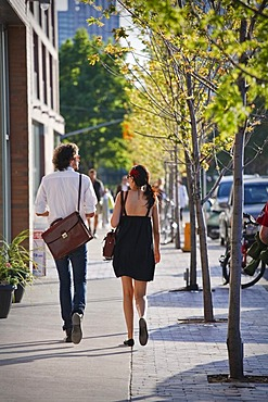 Young couple walking down the street, spring