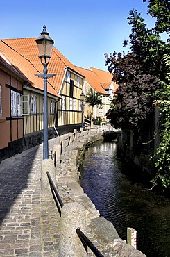 A picturesque little alleyway with river in Bogense, Funen, Fyn, Denmark, Europe