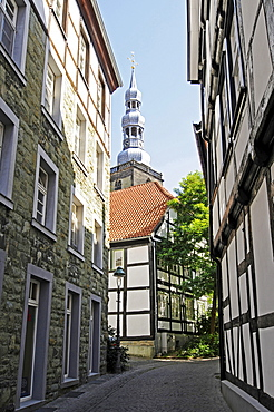 Narrow street, half-timbered houses, church tower, historic town centre, Soest, North Rhine-Westphalia, Germany, Europe