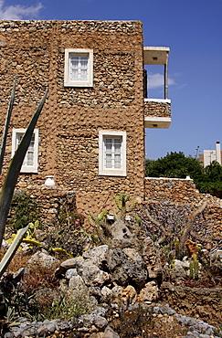 Cactus garden, main building, Lychnostatis Open Air Museum, Museum of the traditional Cretan life, Hersonissos, Crete, Greece, Europe