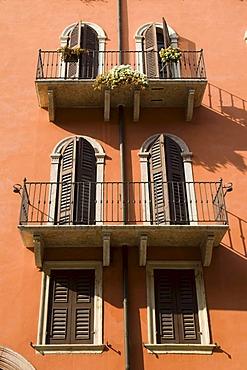 Orange house with twin windows in Venetian style, Verona, Veneto, Italy, Europe