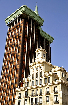 Old clock tower in front of the Torres de Colon building on the Plaza de Colon, Madrid, Spain, Iberian Peninsula, Europe