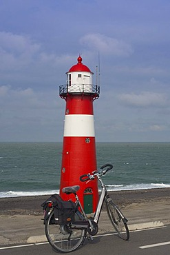 Lighthouse and a bicycle, Westkapelle, Zeeland, Holland, Netherlands, Europe