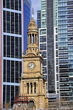 West side of Sydney Town Hall, a Victorian tower, in front of skyscrapers, Sydney, New South Wales, Australia
