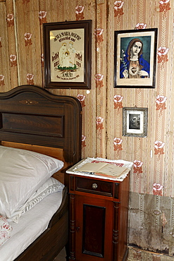 Farmer's bed-room, bed, night stand, pictures of saints on the wall, Haus Haeusing house, farm from 1734, Wolfegg farmhouse museum, Allgaeu region, Upper Swabia, Baden-Wuerttemberg, Germany, Europe