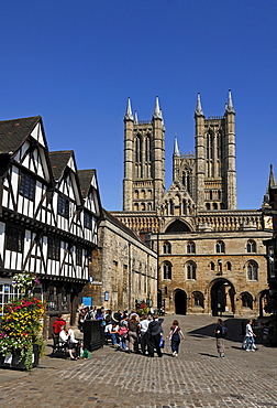 Lincoln Cathedral or St. Mary's Cathedral, 12th and 13th Century, Gothic-Romanesque, front left half-timbered building built in a Tudor style, Minster Yard, Lincoln, Lincolnshire, England, UK, Europe
