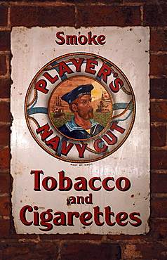 Old metal advertising sign for Player's Navy Cut in a tavern, Cuborough, Staffordshire, England, United Kingdom, Europe