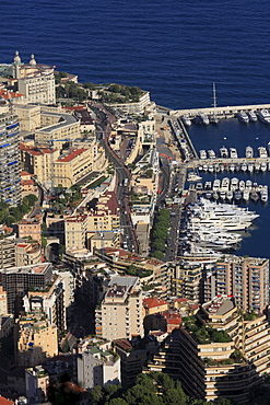 Monte Carlo district with the road leading up to the Casino, the start of the Formula 1 race track, top left, the Casino, and to the right the port of La Condamine with superyachts, Principality of Monaco, Cote d'Azur, Europe
