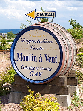 A winery in Romaneche-Thorins advertising on a wine barrel for its Beaujolais wine, Moulin a Vent, Beaujolais, Rhone departement, France, Europe