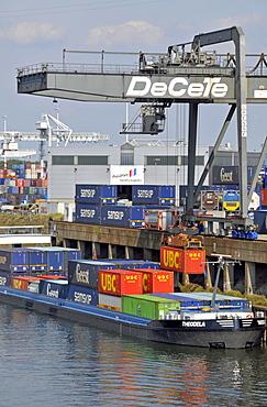 Cargo ship is being loaded, inland port in Duisburg, North Rhine-Westphalia, Germany, Europe