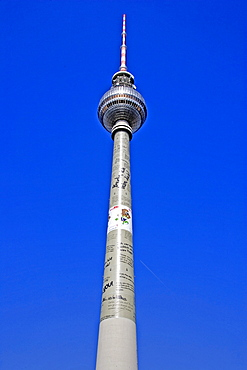 TV tower on Alexanderplatz square used as an advertising pillar, Berlin, Germany, Europe