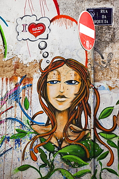 Artistic graffiti of a woman in Faro, Algarve, Portugal, Europe