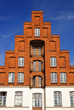 Classical storehouse with typical stepped gable at the upper Trave river, Luebeck, Schleswig-Holstein, Germany, Europe