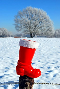 Red boot from Santa Claus in snowscape