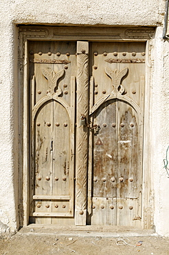 Carved wooden door in the old town of Sur, Sharqiya Region, Sultanate of Oman, Arabia, Middle East